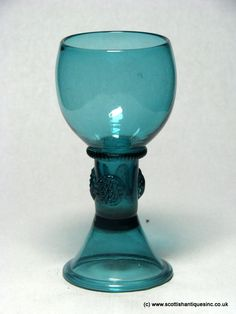 An exceptional Georgian Sea Blue Wine Glass c1750. This is a Roemer in the truest sense, with a cup wrythened bowl with a milled collar at the base. Hollow stem with high conical thin folded foot with snapped pontil.  Dutch or German in origin, this is an exceptional glass and a rare colour. No chips cracks or restoration, it measures 5 ¼ inches tall with a 2 ¼ inch bowl and 2 3/8 inch foot.  http://scottishantiques.com/georgian-wine-glasses/regency-coloured?product_id=1625#.Vj8JJqToq-4