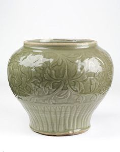 Jar, stoneware with carved decoration of peony scrolls under green 'celadon' glaze, Longquan ware, China, Yuan dynasty, 14th century.Height: 26.7 cm, Diameter: 31.4 cm.712-1883.© V Images.