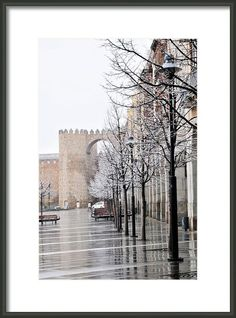Wet And Snowy Avila Framed Print By Angela Bonilla.  Avila, Spain main square.  Medieval walls.