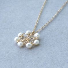 Pearl Flower Necklace, Bridal Pearl Necklace, Bridesmaids Necklace Pearl, Crochet Gold Wire, Crochet Wire Necklace. $40.00, via Etsy.