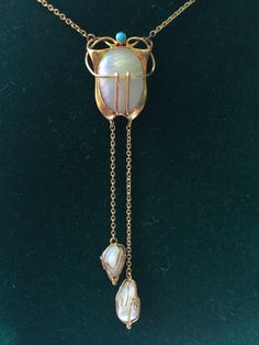 Jugendstil gold & pearl pendant. Renaissance Fine Jewelry adores this beautiful jewel! For fine antique jewelry visit us at 151 Main St. Brattleboro, Vermont.