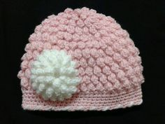 This cute crochet hat uses popcorn stitches to create a great texture.