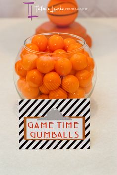 Orange gumballs serve as GAME TIME GUMBALLS for a basketball themed party -guess how many per jar... Winner takes them all!!