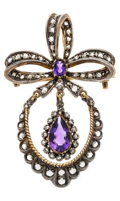 Diamond, Amethyst, Silver-Topped Gold Pendant-Brooch The pendant-brooch features a pear-shaped amethyst measuring 12.00 x 7.00 mm and weighing approximately 2.00 carats, enhanced by an an oval-shaped amethyst weighing a approximately 0.20 carat, accented by native-cut diamonds weighing a total of approximately 0.85 carat, set in silver-topped 18k gold. Victorian or Victorian style.