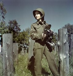 Sgt. Karen Hermiston, CWAC, with Speed Graphic Camera from WWII.