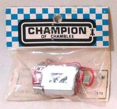 Champion brand slot car motor, still in the original packaging.