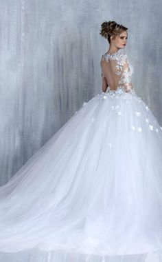Glamorous sheer lace embroidered long-sleeve floral applique ballgown wedding dress; Featured Dress: Tony Chaaya