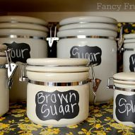 I organized my pantry with chalkboard vinyl labels, canisters, and baskets from Goodwill