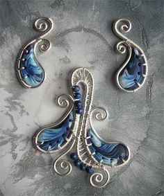 Handcrafted wire work and polymer clay with lapis... pendant and earrings alkhymeia.jimdo.com/