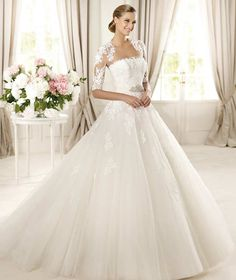 Pronovias full tulle ball gown with lace bodice. Minus the jacket..