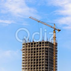 Qdiz Stock Photos | Building crane on construction,  #architecture #blue #build #building #built #business #City #construct #construction #crane #development #engineering #equipment #estate #growth #house #industrial #industry #modern #site #sky #steel #technology #urban #work