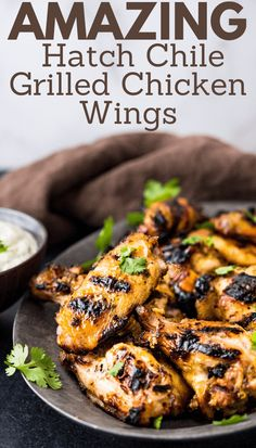 Learn how to make these easy grilled chicken wings on a gas grill, charcoal grill or even in the oven. The simple homemade marinade is great in the dipping sauce too. This classic recipe shows you how to grill them and how long to cook the spicy, meaty chicken wings for game day or anytime. #chickenwings #grilledwings