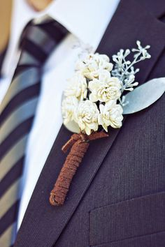 mini balsa wood boutonniere wrapped in suede string.