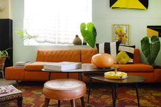 The orange sofa was found at local Puerto Rico shop Cosas de Ayer y Hoy.