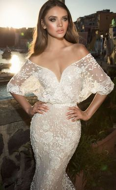 Featured Dress: Julie Vino; Sheer off-the-shoulder sleeve wedding dress.