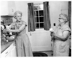 Senator Margaret Chase Smith arranges flowers in the kitchen of her Skowhegan, Maine home, June 1955.