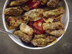 Armenian Stuffed Cabbage (Dolmas) - - What to eat with a glass of Armenian areni? Dolmas, of course. Beef, grains, and herbs are wrapped in cabbage or grape leaves, and are served at nearly every meal. Cabbage Recipes, Beef Recipes, Cooking Recipes, Fall Recipes, Kohlrabi Recipes, Hamburger Recipes, Kitchen Recipes, Clean Recipes, Summer Recipes