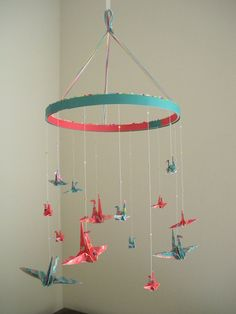 In pink and purple, hanging from a fabric wrapped styrofoam hoop with fishing wire. Crane Mobile, Collaborative Art Projects, Origami And Kirigami, Origami Animals, Silent Auction, Wooden Frames, Scrapbook Paper, Wind Chimes, Baby Shower Gifts