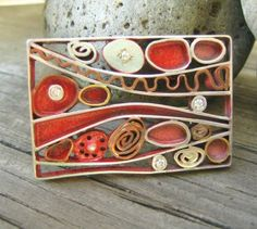 Maureen Brusa Zappellini: Brooch, Sterling Copper and Brass with white cz and red enamel paint