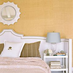 Modern bedroom with extra-wide headboard with nailhead trim