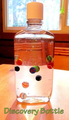 Discovery Bottle: Corn Syrup and Marbles. Very relaxing to watch:)