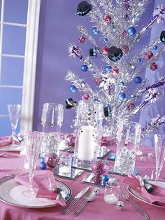 Welcome guests to a party that reflects your mood for the season.  A New Year's table filled with sparkle, bright colors, and retro decorations leaves no doubt that fun is in store.