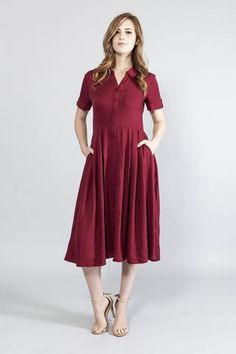 Trending, Cute, Sexy Red Midi Shirt-Dress Short sleeves with button-tab detail Shirring waist detail Collar Front button closure Unlined