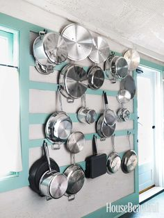 Hang pots and pans on your kitchen wall. Design: Jeffrey Bilhuber. #kitchen #storage