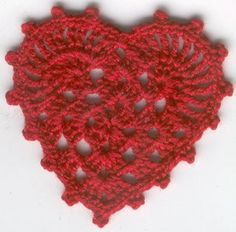 My favorite crochet heart applique - starts with a granny square - http://undisthreadness.blogspot.com/2006/02/litle-granny-square-heart.html