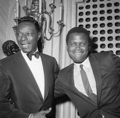 """Sidney Poitier and Nat """"King"""" Cole cutting up at the 1963 #Oscars at the Santa Monica Civic Auditorium, April 8, 1963.  Photo: Michael Ochs Archives, Corbis."""