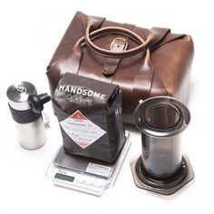 The kit comes neatly packed with anAeropress, a 12oz bag of fresh roasted Handsome coffee, a Porlex mini grinder, an AWS scale and extra pa...
