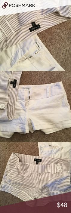 Bebe shorts bundle !!! Who is ready for some nice weather and hott shorts to enjoy with it these are so comfy and yet super in style !!! The white one has a small stain but just needs to be bleached the other pair I only wore for a few hours. In the tan and white stripe is a size 8 the white are a size 6 bebe Shorts Jean Shorts