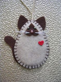 45 Button and Felt Holiday DIY Christmas Ornaments. Felt ornaments are simple DIY felting projects and inexpensive to make. You will buy all supplies in felt craft and sewing stores. 45 Button and Felt DIY Christmas Ornaments Felt Christmas Decorations, Felt Christmas Ornaments, Christmas Diy, Xmas, Wine Bottle Crafts, Mason Jar Crafts, Sewing Crafts, Diy Crafts, Sewing Tips