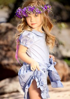 Purple floral crown on flower girl