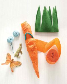 Crepe Paper Carrots | Martha Stewart ~ Made of wrapped paper streamers, these adorable little bundles are a twist on the crepe-paper surprise ball. As you unwind the paper, you find the trinkets -- jewelry, a novelty, a toy. It's simple to grow a basketful and customize them for guests of any age. Display them as a centerpiece or leave them by the door as favors.