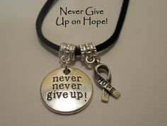 Never Give Up Inspirational and Hope Ribbon Pendant Necklace Unisex Silver or Black Suede