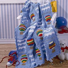 "Balloons always inspire high spirits, and the colorful hot-air vessels on this uplifting afghan are no exception! The cover-up's sky-blue softness and lively motifs will awaken the imagination and add a playful touch to your favorite youngster's room Our design is crocheted using worsted weight yarn and a size H (5.00 mm) hook. Number of Designs: 1 afghan Approximate Design Size: 40"" x 49"""