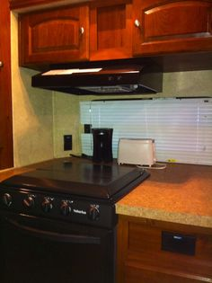 How to organize kitchen cupboards in a travel trailer. Storage solution. Ideas on how to keep things organized.