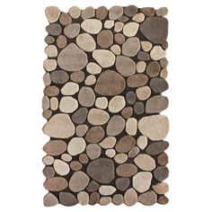 Outdoor style goes indoors with the nuLOOM Pebbles Rug. This stylish, modern area rug is made from hand-tufted wool and features a durable canvas backing and medium pile that is soft under the feat while still standing up to wear and tear. A raised, pebble like design in earthy tones makes this accent rug a real standout. Available in two color schemes and a variety of sizes.