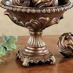 Easily decorate any room by pairing the Jeneva Acanthus Centerpiece Bowl with the Jeneva Acanthus Orb Set. Polystone accessories have a bronze finish,. Greenery Centerpiece, Candle Centerpieces, Crown Wall Decor, Kirkland Home Decor, Blue Shutters, World Decor, Tuscan Decorating, Diy Decorating, Mediterranean Home Decor