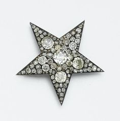 DIAMOND STAR BROOCH, CIRCA 1870 Set with 4 old-mine diamonds and numerous smaller old-mine and rose-cut diamonds weighing approximately 6.00 carats, mounted in gold and silver.