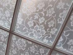 DIY lace cornstarch window treatment.