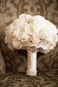Embellished Ivory Bouquet | Photography: Laurie Bailey Photography.w Read More:  http://www.insideweddings.com/weddings/jewish-ceremony-modern-reception-with-black-and-white-details/834/