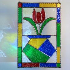 Tulip Vase Stained Glass Panel by colorandlight on Etsy, $59.00