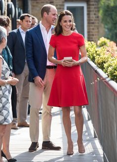 Catherine, Duchess of Cambridge, in L.K. Bennett dress and bag, Kiki McDonough earrings, Cartier watch, Gianvito Rossi shoes.