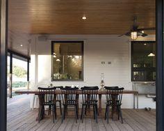 Elegant Farm House Design; Spring Decorating Ideas: Wooden Dining Table Black Chairs Springdale Farmhouse Patio