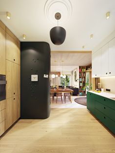 Rich greens and light woods, plant accents, natural light, and unique fixtures in an open floor plan make this contemporary apartment feel fresh and lively. Antique Living Rooms, Living Room Art, Living Room Modern, Modern Apartment Design, Contemporary Apartment, The Secret Garden, Futuristisches Design, Modern Hallway, Green Accents