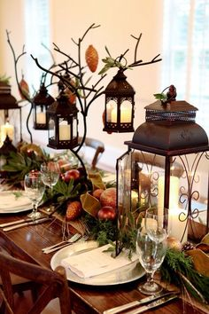 Fabulous Rustic Holiday Table...with lanterns and metal twiggy branches with glass ornaments. You could always use real tree branches and cement them into a clay pot or tin can. By The Frosted Petticoat.:
