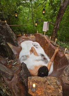 This clever tub mimics the look of real rock, making it a seamless part of the outdoors. Light some candles and hang some lanterns, and you'll feel like civilization is a million miles away. wowww i need this