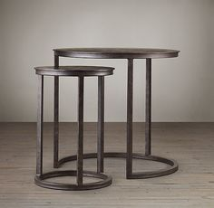 """$590    Sheet metal top  Supported by a trio of square-pipe legs and ring base  Natural metal finish  Set of 2 nesting tables  Catalog and Web only  DIMENSIONS  Small Nesting Table: 18"""" diam., 24""""H  Large Nesting Table: 24"""" diam., 26""""H"""